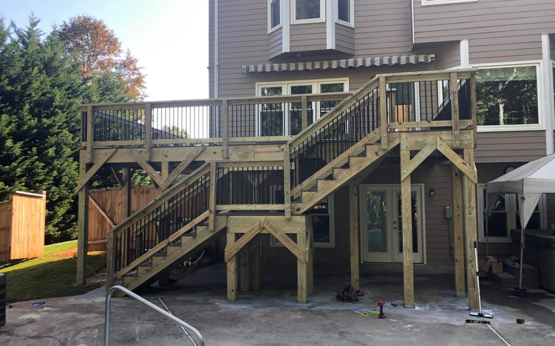 Deck with composite decking and round metal balusters